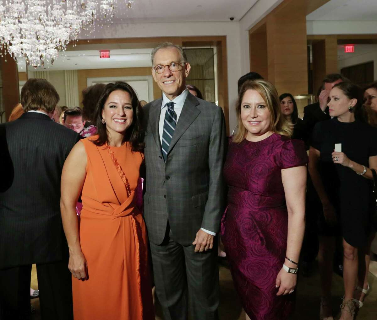 Mercedes Abramo, President and CEO of Cartier North America, Gary Tinterow, Director of the MFAH, and Kari Gonzales, boutique director