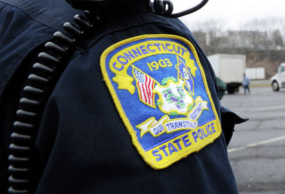 Connecticut State Trooper Perry Wilson on the job inspecting trucks at the weigh station off Interstate 95, Greenwich, Thursday, March 10, 2011. The administration's desire to move troopers out of the weigh stations prompted a fight between lawmakers and the union. Photo: Bob Luckey / Bob Luckey / Greenwich Time