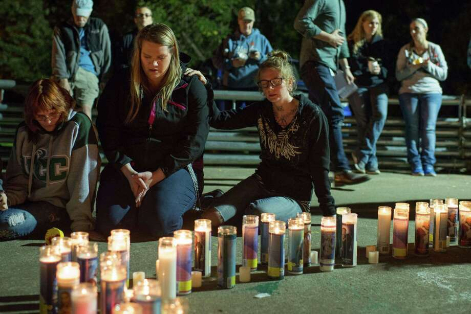 People pray during a candlelight vigil in Roseburg, Oregon late on Thursday for ten people killed and seven others wounded in a shooting at a community college in the western U.S. state of Oregon. The shooter opened fire in a classroom at Umpqua Community College in rural Roseburg, then moved to other rooms methodically gunning down his victims, witnesses said. Photo: CENGIZ YAR JR. /AFP / Getty Images / AFP