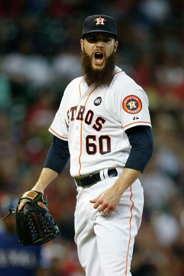 Houston Astros starting pitcher Dallas Keuchel (60) screams after striking out Texas Rangers first baseman Mike Napoli, breaking the record with 204 strikeouts, most by an Astros lefty in a season in club history, during the first inning of an MLB game at Minute Maid Park on Sunday, Sept. 27, 2015. ( Karen Warren / Houston Chronicle ) Photo: Karen Warren, Staff / © 2015 Houston Chronicle