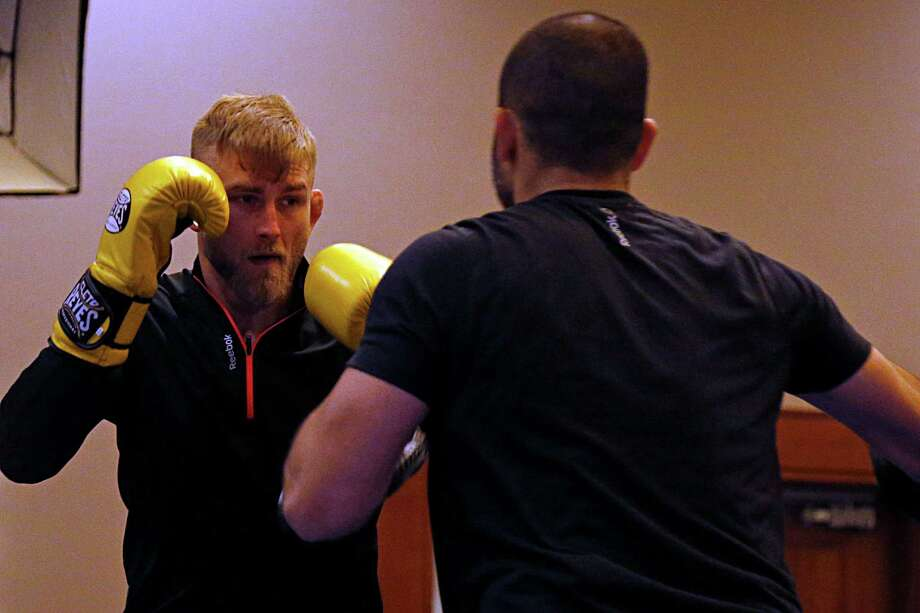 UFC fighter Alexander Gustafsson left, during workouts at the Westin Houston Memorial City for Saturday's UFC 192 Wednesday, Sept. 30, 2015, in Houston.