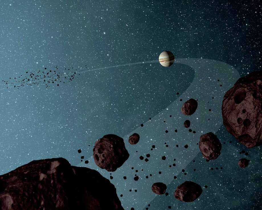 This is an artist's concept of the Jovian Trojan asteroids. SwRI scientist Harold Levison says they are believed to be remnants from the formation of the solar systems outer gas giants: Jupiter, Saturn, Uranus and Neptune. Photo: Stocktrek Images / Stocktrek Images