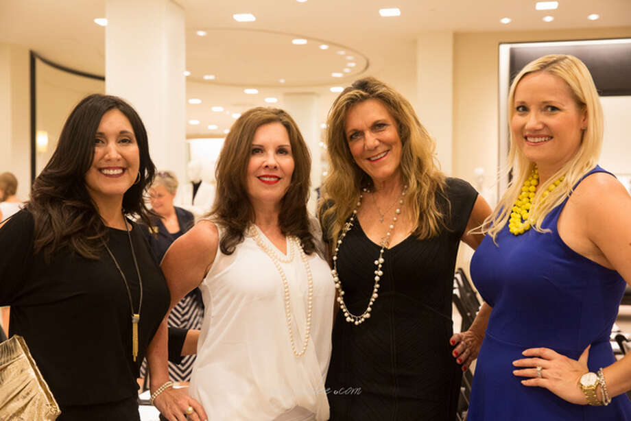 "Agents Jennifer Lucio (left), Patti Prasher, Peggie Pentecost, Nicole Brende (right) participated in the Women's Council of Realtors, Houston Chapter, ""Houston is Haute"" fashion event held at Saks Fifth Avenue."