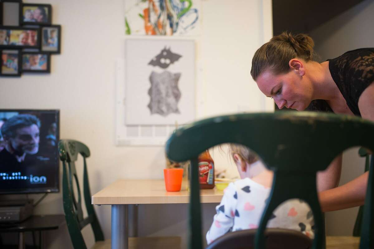 Julianne Carus and Lilith Carus, 2, sit down for dinner on Wednesday, Sept. 30, 2015 in San Francisco, Calif. San Francisco is the first city to offer a grant to pay for diapers of parents who cannot afford them.