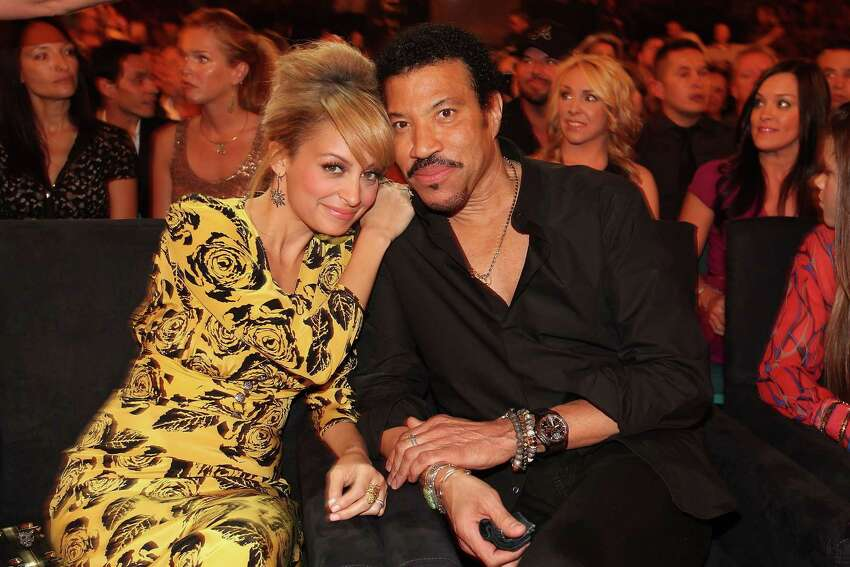 Lionel Richie and his wife adopted daughter Nicole Richie.