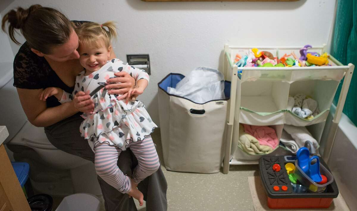 Julianne Carus and Lilith Carus, 2, share a moment on Sept. 30, 2015 in San Francisco, Calif. San Francisco is the first city to offer a grant to pay for diapers of parents who cannot afford them.