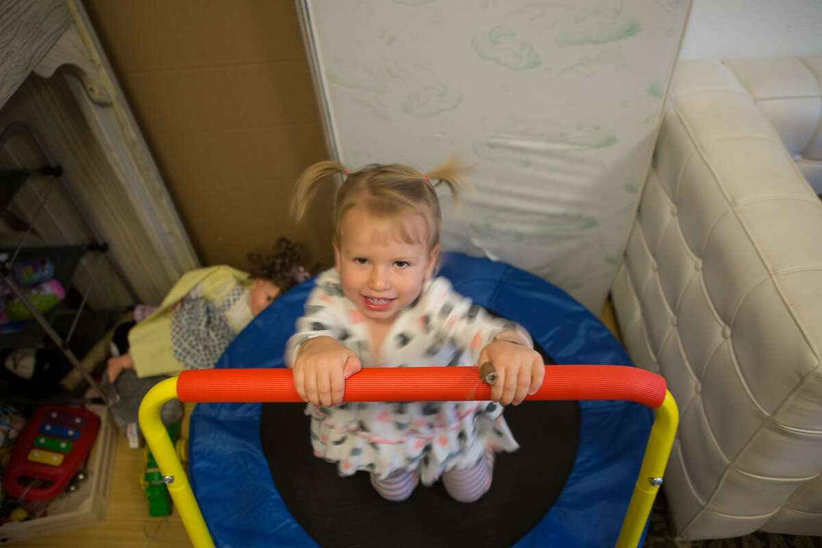 Lilith Carus, 2, plays on a trampoline after dinner on Wednesday, Sept. 30, 2015 in San Francisco, Calif. San Francisco is the first city to offer a grant to pay for diapers of parents who cannot afford them.