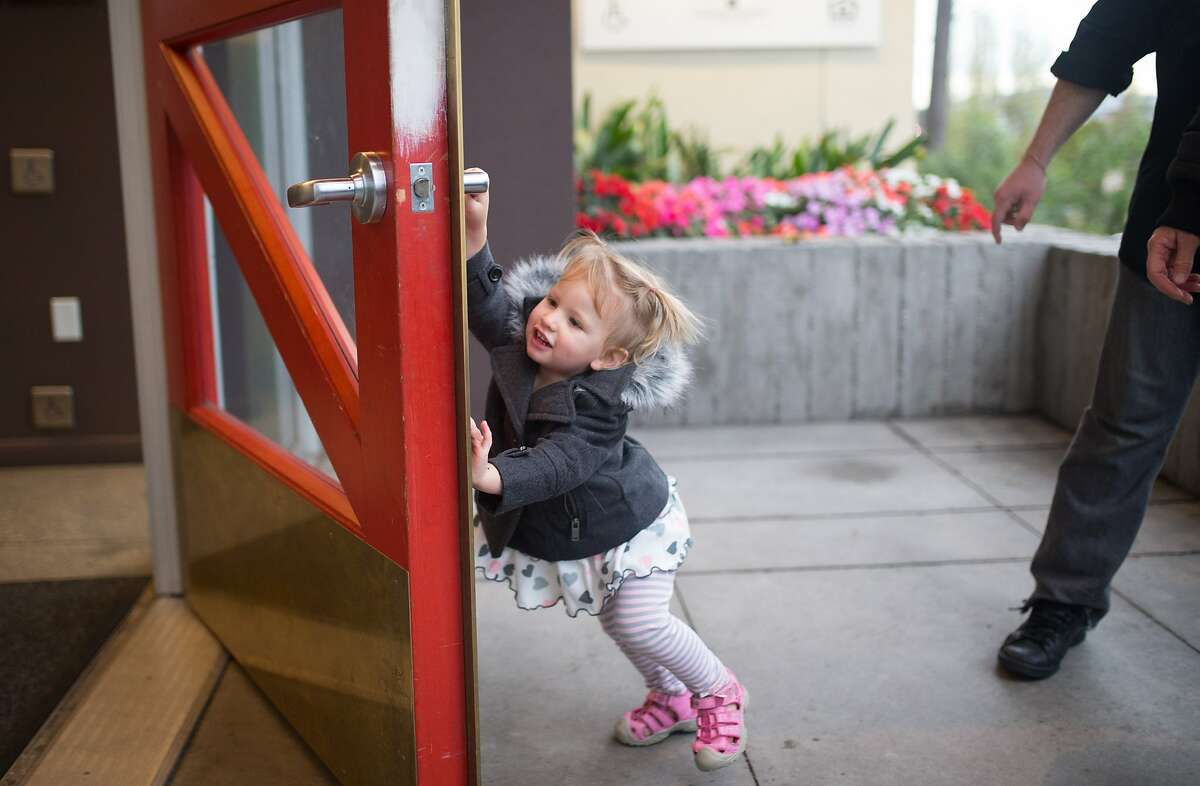 Lilith Carus, 2, closes the door to her building on her way out for a walk with her father and mother on Sept. 30, 2015 in San Francisco, Calif. San Francisco is the first city to offer a grant to pay for diapers of parents who cannot afford them.
