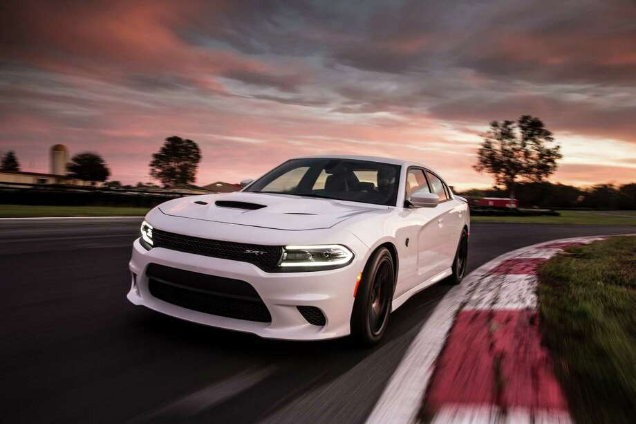 The sinister-looking SRT Hellcat won't fool many into thinking it's your average Dodge sedan, thanks to the cold-air intake in its aluminum hood and extractors that help remove heat from the engine compartment. Photo: Dodge