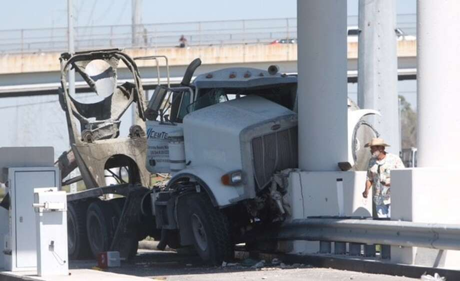 A cement truck rammed into an unmanned toll booth Friday along the Hardy Toll Road in northeast Houston.