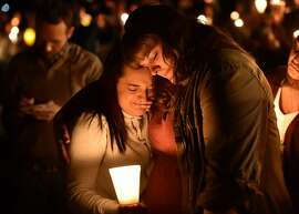 "Mourners react during a vigil in Roseburg, Oregon on October 1, 2015, for ten people killed and seven others wounded in a shooting at a community college in the western US state of Oregon. The 26-year-old gunman, identified by US media as Chris Harper Mercer, was killed following a shootout with police. A visibly angry President Barack Obama made an impassioned plea for gun control in the wake of the shooting, blasting Congress for its failure to act in the face of ""routine"" mass killings.  AFP PHOTO/JOSH EDELSONJosh Edelson/AFP/Getty Images"