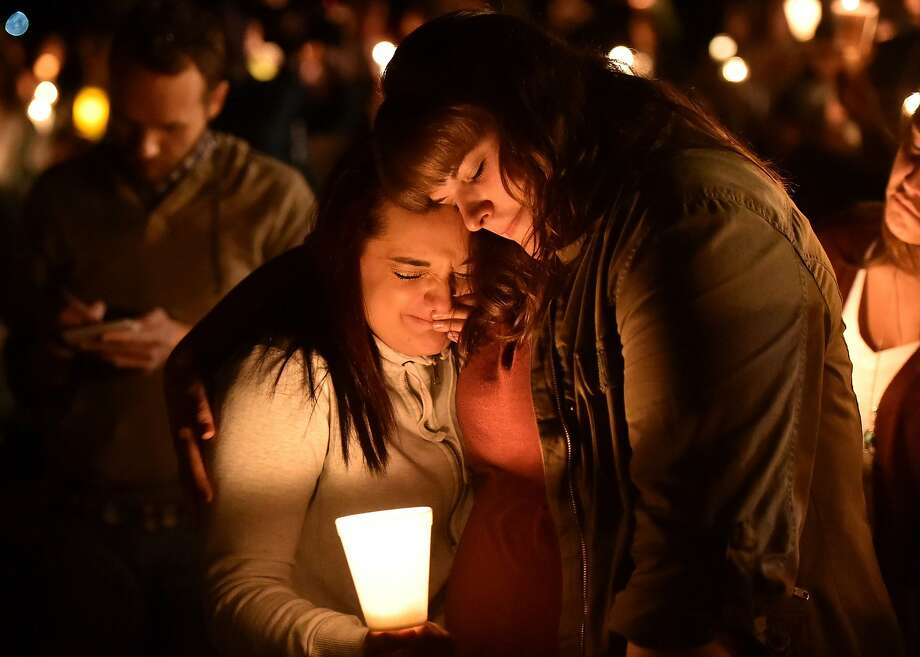 Mourners hold a vigil Thursday night in Roseburg, Ore., for the 10 people killed and seven wounded during a shooting at a community college. Photo: Josh Edelson, AFP / Getty Images