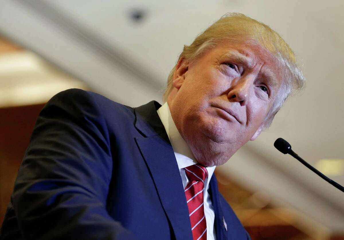 Republican presidential candidate Donald Trump pauses while speaking about his tax plan during a news conference, Monday, Sept. 28, 2015, in New York. The Republican front-runner is calling for an overhaul of the tax code that would eliminate income taxes for millions of Americans, while lowering them for the highest-income earners and business.(AP Photo/Julie Jacobson)