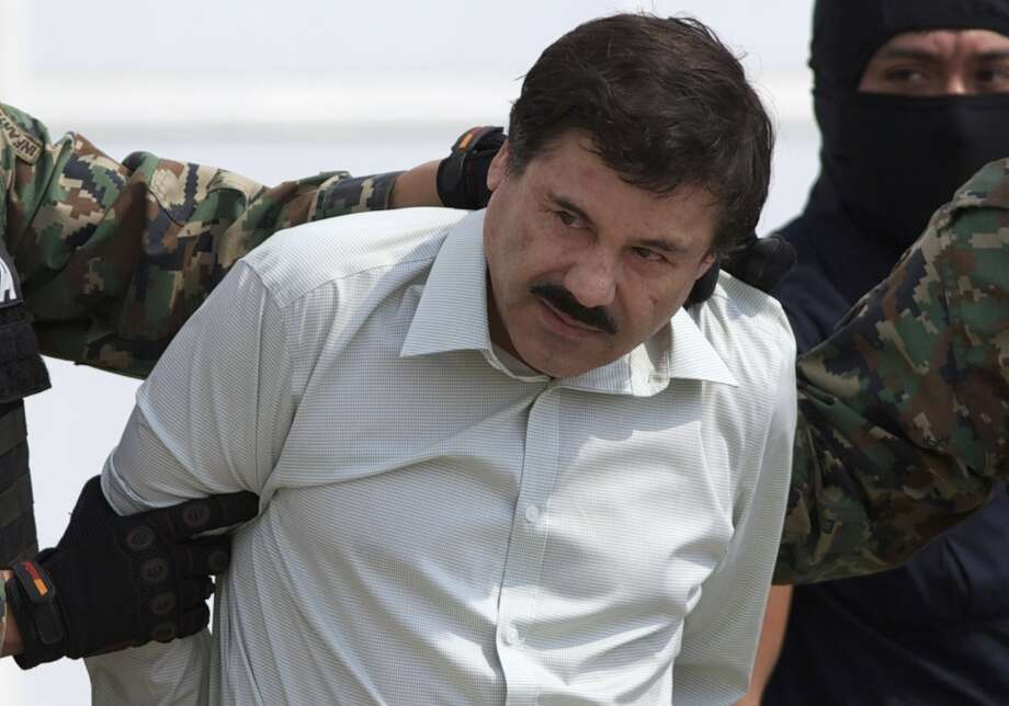 """FILE - This Feb. 22, 2014 file photo shows Joaquin """"El Chapo"""" Guzman, the head of Mexico's Sinaloa Cartel, being escorted to a helicopter in Mexico City following his capture overnight in the beach resort town of Mazatlan. A judge in Mexico has issued a second arrest warrant to detain escaped drug lord Joaquin """"El Chapo"""" Guzman based on an extradition request from the United States. The federal prosecutors' office said Wednesday, Sept. 23, 2015 the new warrant is for U.S. charges of organized crime, money laundering drug trafficking, homicide and others. Guzman escaped on July 11, 2015 through a tunnel from Mexico's highest-security prison. (AP Photo/Eduardo Verdugo, File) Photo: Associated Press"""