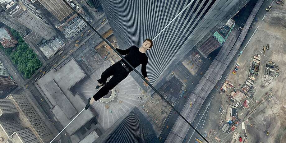 """Philippe Petite (Joseph Gordon-Levitt) lies down during his famous 1974 wire walk between the Twin Towers in """"The Walk."""" Photo: Handout, Washington Post"""