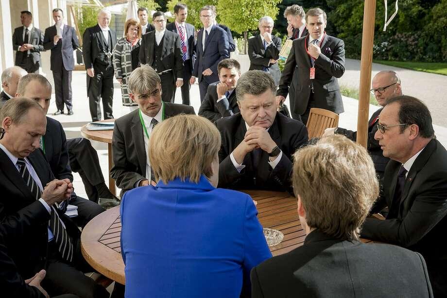 Leaders meeting for talks on Ukraine include German Chancellor Angela Merkel, Russian President Vladimir Putin, Ukrainian President Petro Poroshenko and French President Francois Hollande. Photo: Mikhail Palinchak, Associated Press