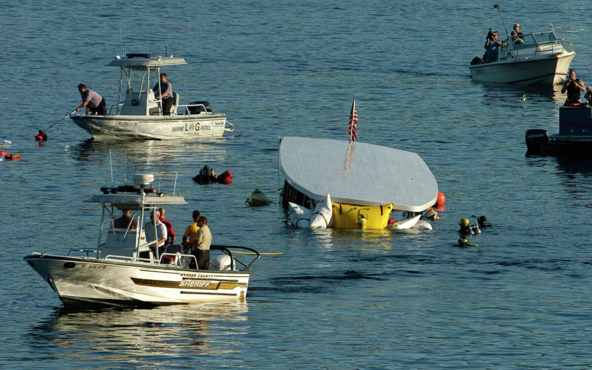 Salvage divers and State Police divers work in Lake George on October 3, 2005, as the tour ship Ethan Allen is raised from 70' below surface of the lake after capsizing and taking the lives of 20. Click through the gallery for photos following the tragedy.