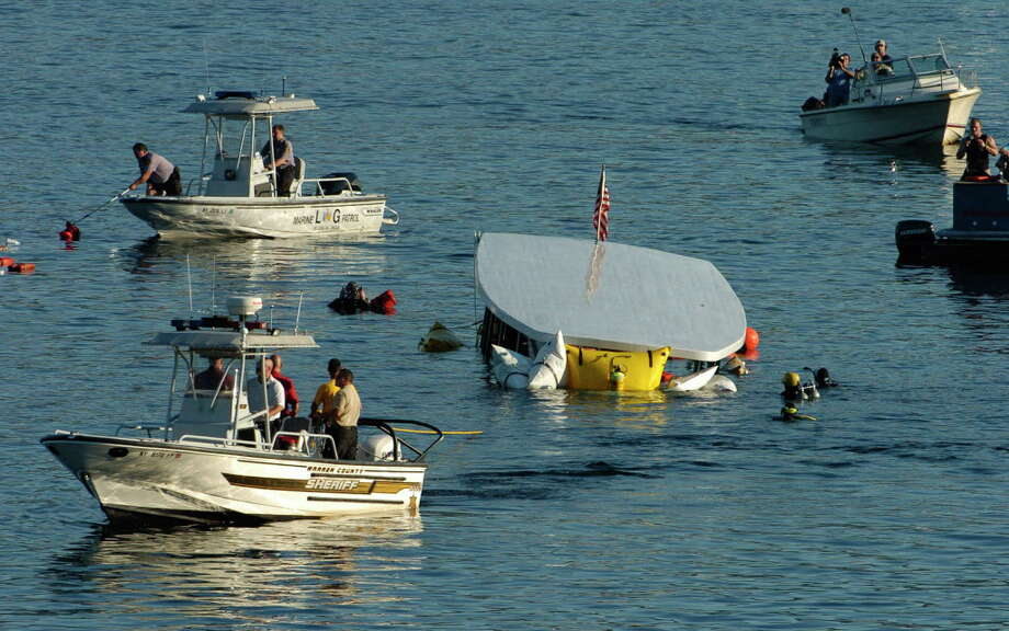 Salvage divers and State Police divers work in Lake George on October 3, 2005, as the tour ship Ethan Allen is raised from 70' below surface of the lake after capsizing and taking the lives of 20 elderly tour passengers. (Skip Dickstein/Times Union archive) Photo: SKIP DICKSTEIN / ALBANY TIMES UNION