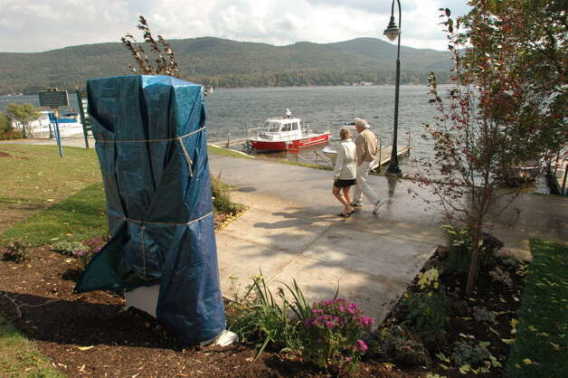 A monument to the Ethan Allen boat accident victims sits covered at the edge of Shepherd Park along the shore the lake at  Lake George, NY, on Sept. 28, 2006. The monument was unveiled on October 1, 2006.  (Michael P. Farrell/Times Union archive) Photo: MICHAEL P. FARRELL / ALBANY TIMES UNION