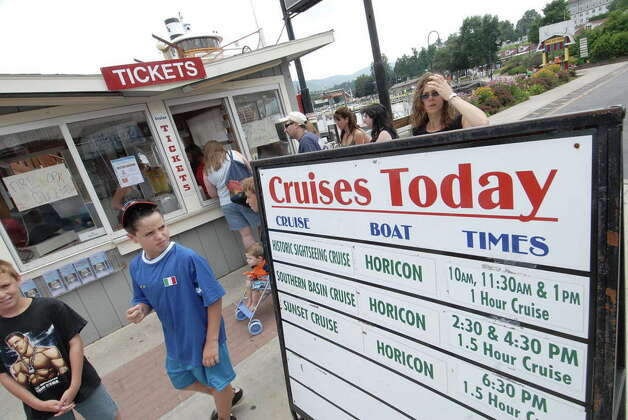 Summer vacationers line up for boat cruise tickets at the Shoreline Marina where the Ethan Allen boat that overturned was once docked,  Tuesday, July 25, 2006. (Michael P. Farrell/Times Union archive) Photo: STEVE JACOBS / ALBANY TIMES UNION