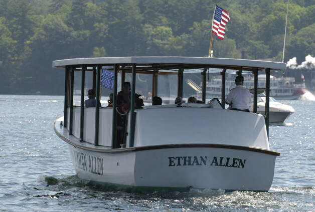 The glass-enclosed tourist boat the Ethan Allen moves out into the center of Lake George on a floating classroom tour of the lake on July 20, 2005, in Lake George, N.Y.  The boat overturned on Sunday, Oct. 2, 2005 in the lake, killing 20 people. (Skip Dickstein/Times Union archive) Photo: SKIP DICKSTEIN / ALBANY TIMES UNION