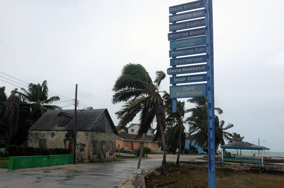 The sky is overcast on south Eleuthera island, Bahamas, early Friday, Oct. 2, 2015 as Hurricane Joaquin dumps torrential rains across the eastern and central Bahamas as a Category 4 storm. Streets were largely deserted as people remained hunkered down on the island of Eleuthera, which was bracing for heavy winds later Friday. (AP Photo/Ben Fox) Photo: Ben Fox, Associated Press