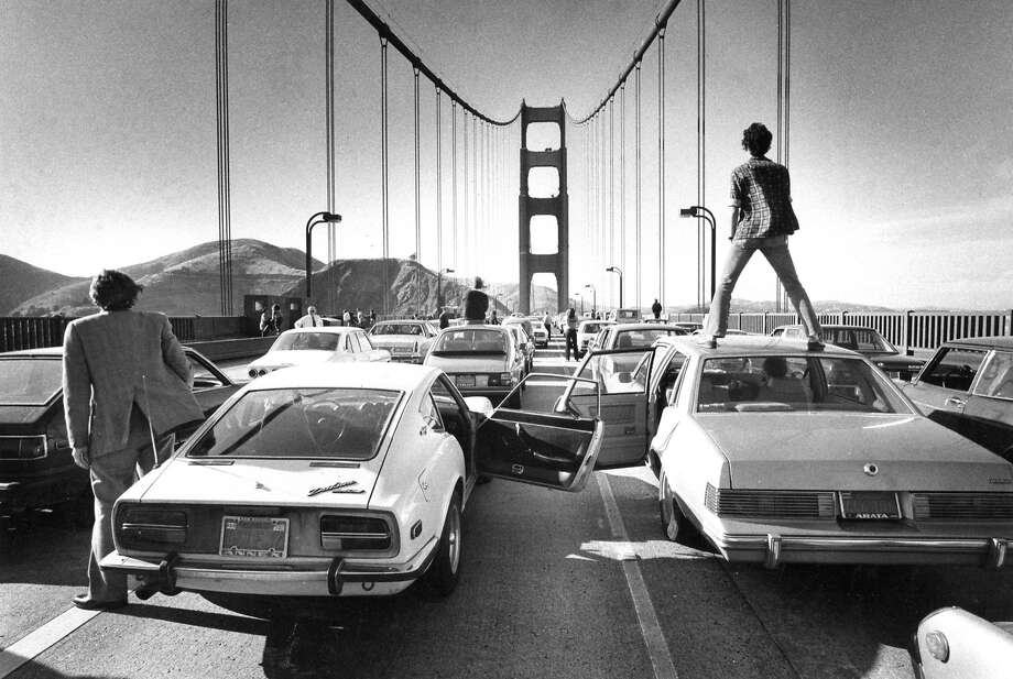 June 3, 1980: Commuters can only stand and watch as a traffic jam forms on the Golden Gate Bridge. This beautiful image was taken by longtime Chronicle photographer and photo editor Gary Fong, who was stuck in the same gridlock, stepped outside his car, and took one of the most memorable photos in Chronicle history. Photo: Gary Fong, The Chronicle