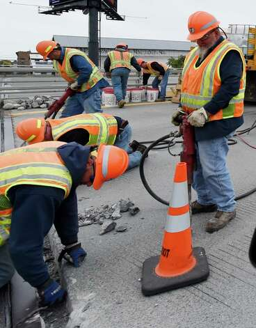 Emergency repairs to expansion joints of the east bound lane on the I-90 overpass over Broadway are made Friday morning Oct. 2, 2015 in Albany, N.Y.        (Skip Dickstein/Times Union) Photo: SKIP DICKSTEIN / 10033607A
