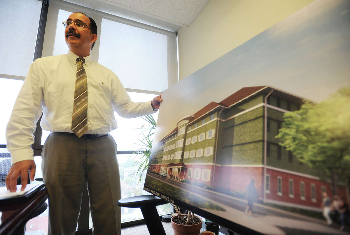 University of Bridgeport Vice President of Facilities George Estrada shows an illustration of the school's new state of the art domitory under construction on the campus in Bridgeport, Conn. on Tuesday, September 29, 2015.