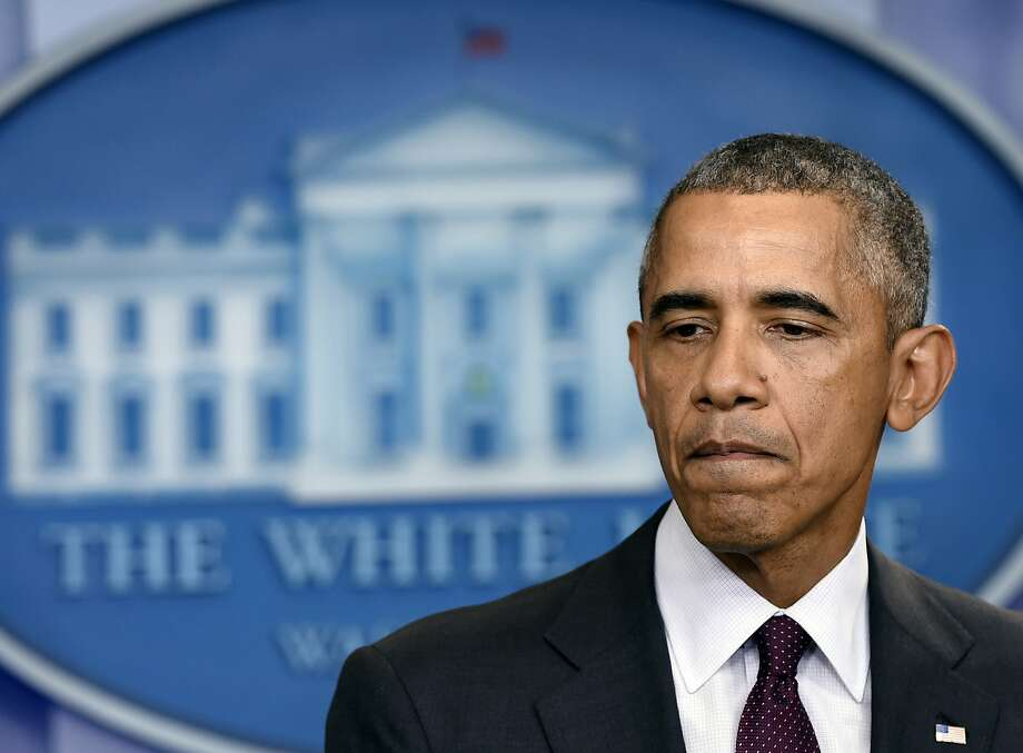 President Obama pauses as he speaks in the Brady Press Briefing Room at the White House on Thursday about the shooting at Umpqua Community College in Roseburg, Ore., about 180 miles south of Portland. Photo: Susan Walsh, Associated Press