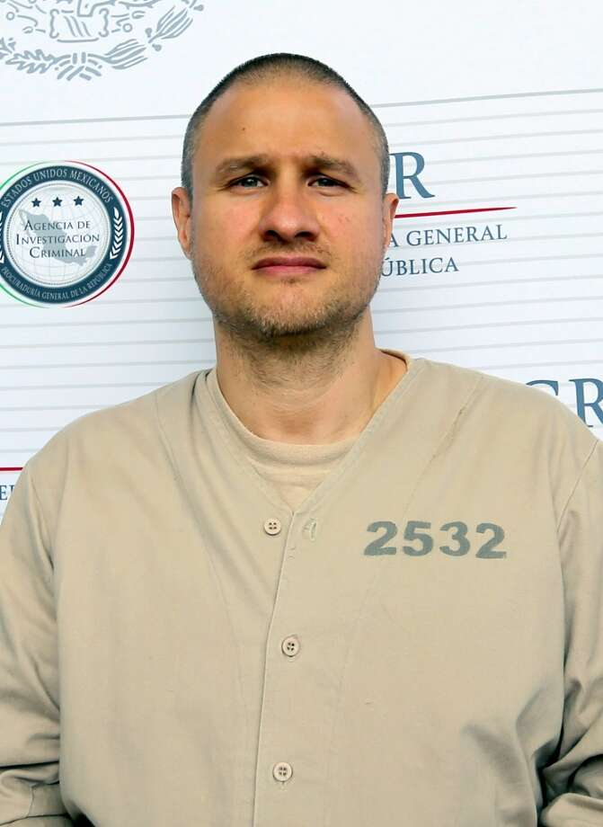 "Handout picture released by Mexico's General Attorney's office showing Edgar Valdez Villareal aka ""La Barbie"", of the Beltran Leyva drug cartel in Mexico City on September 30, 2015. US-born Valdez Villarreal was extradited to the US alongside 12 other criminals, the Mexican General Attorney's office announced on September 30, 2015. The 37-year-old was a key lieutenant of Arturo Beltran Leyva, who headed the cartel that bears his name. AFP PHOTO/GENERAL ATTORNEY'S OFFICE        RESTRICTED TO EDITORIAL USE - MANDATORY CREDIT ""AFP PHOTO/GENERAL ATTORNEY'S OFFICE"" - NO MARKETING NO ADVERTISING CAMPAIGNS - DISTRIBUTED AS A SERVICE TO CLIENTSHO/AFP/Getty Images Photo: AFP / Getty Images"