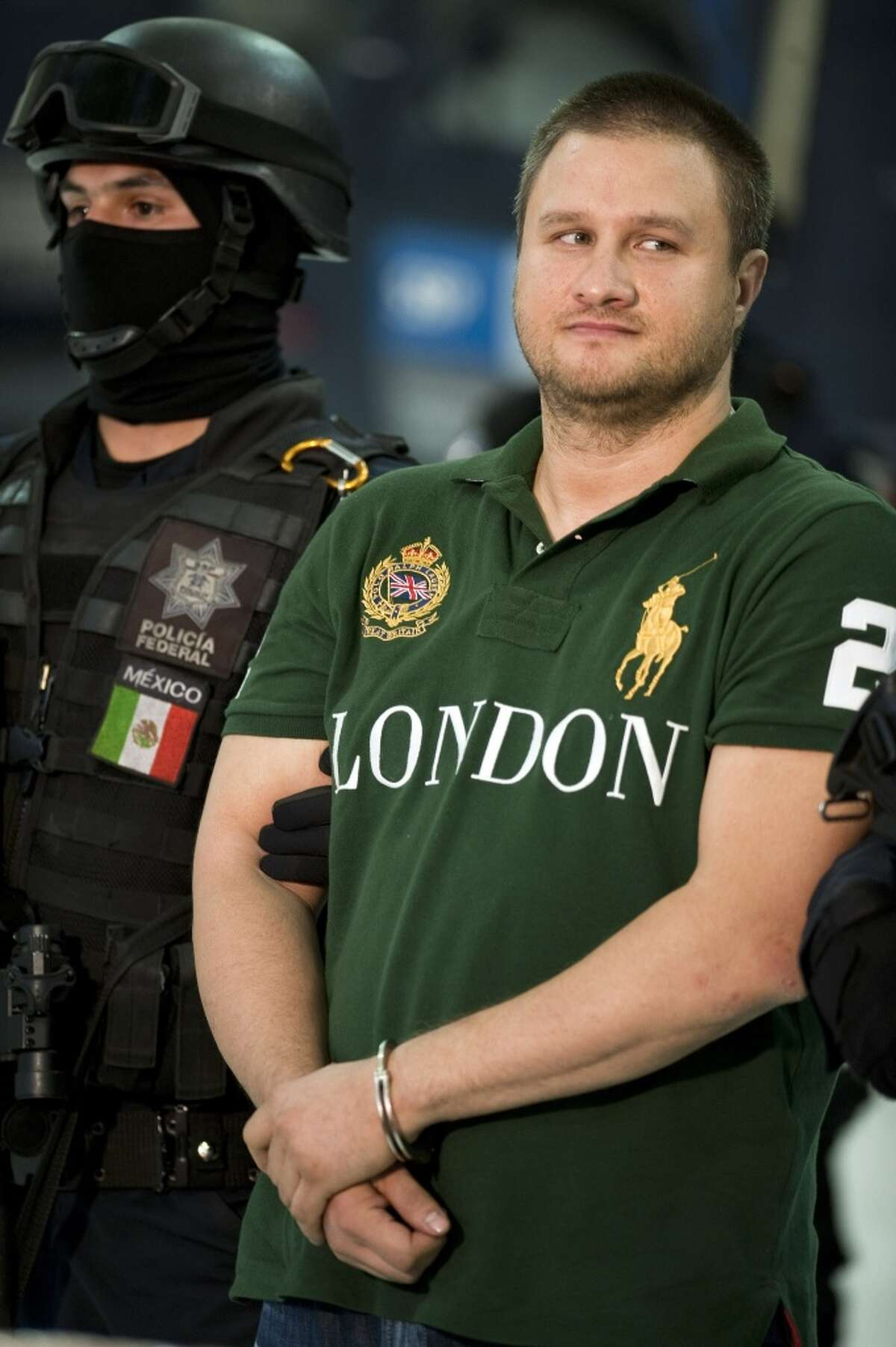Edgar Valdez Villareal aka 'La Barbie' of the Beltran Leyva drug cartel, is presented to the press at the Federal Police headquarters in Mexico City, on August 31, 2010. Mexican authorities on Monday announced the capture of one of the country's most sought after drug kingpins, US-born Valdez Villarreal, known as 'the Barbie' for his fair complexion. Valdez was detained in a police operation in central Mexico, following intelligence work which began in June 2009. The 37-year-old was a key lieutenant of Arturo Beltran Leyva, who headed the cartel that bears his name and was Mexico's third most-wanted man until his December 2009 death in a military operation. AFP PHOTO/Alfredo Estrella (Photo credit should read ALFREDO ESTRELLA/AFP/Getty Images)