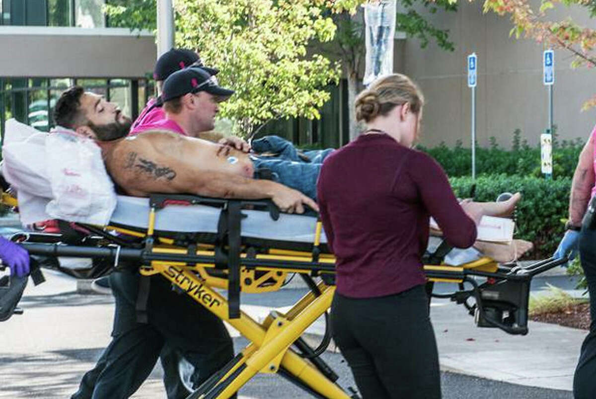 Chris Mintz is wheeled into Mercy Medical Center Thursday morning with multiple gunshot wounds. Mintz, 30, is being credited on social media with tackling the shooter at Umpqua Community College.