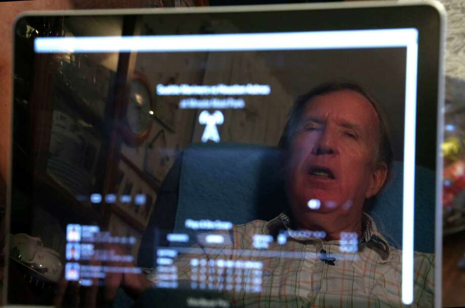 Danny Flowers is reflected in the screen of a computer as he listens to a broadcasted Astros game. Flowers is a nearly blind Astros fan living between Borne and Bandera in Pipe Creek who has been a fan since 1962 and listens to every game on the radio. He hasn't attended a game since the Astrodome days. Photo: Karen Warren /Houston Chronicle / © 2015 Houston Chronicle