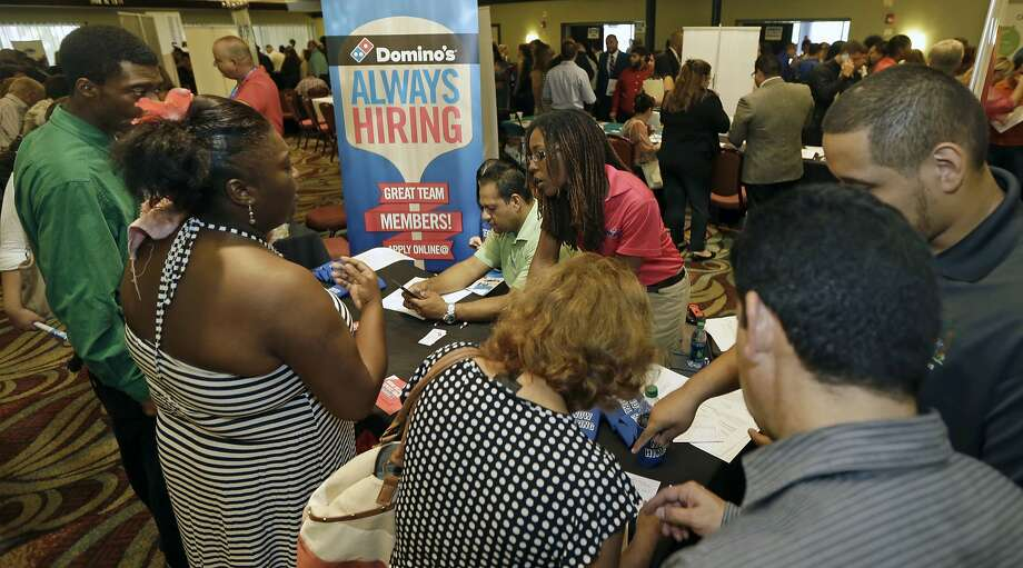 People looking for work attend a Florida job fair in July. Friday's report showed weakness in hiring that could lessen the chances of an interest rate increase from the Fed. Photo: Alan Diaz, Associated Press