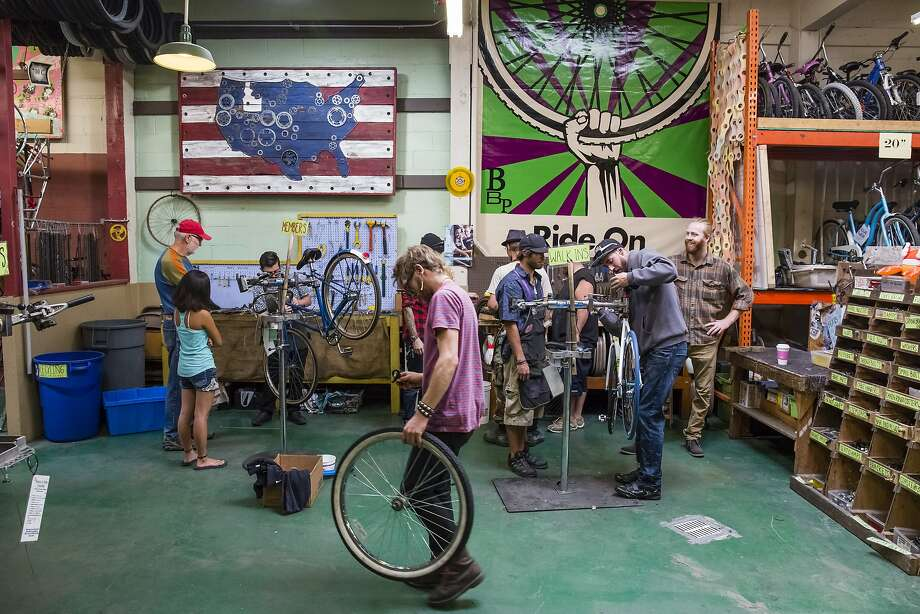 Employees and customers work on bikes in the workshop area at Boise Bicycle Project on Friday, October 2, 2015, in Boise, Idaho. Photo: Otto Kitsinger, Special To The Chronicle