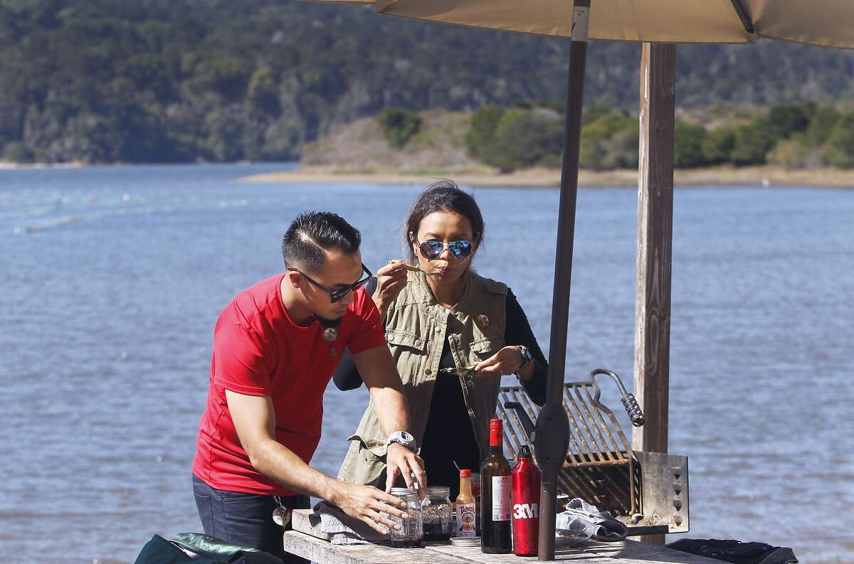 Chris and Jeanne Cadiz of Modesto celebrate their fifth wedding anniversary with a picnic at the Tomales Bay Oyster Company in Marshall, Calif. on Friday, Oct. 2, 2015. The popular spot on the eastern shore of Tomales Bay is being to forced to close down its picnic areas by Marin County citing a concern for parking and traffic issues along Highway 1.