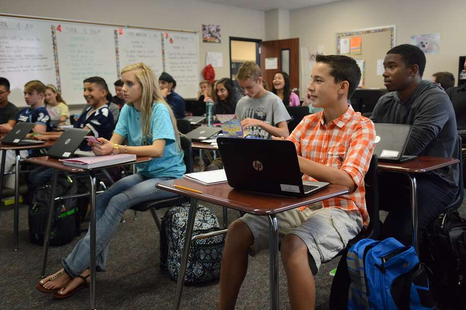 Madeline Faulkner, 16, from left, Trevor Chumley, 14, a freshman, and Mason Cooke, 16, a junior, and their classmates use their Chromebooks during their Spanish III Pre-AP class with teacher Rosalinda Osnaya at Tomball Memorial High School on Oct. 1, 2015. (Photo by Jerry Baker/Freelance) Photo: Jerry Baker, Freelance