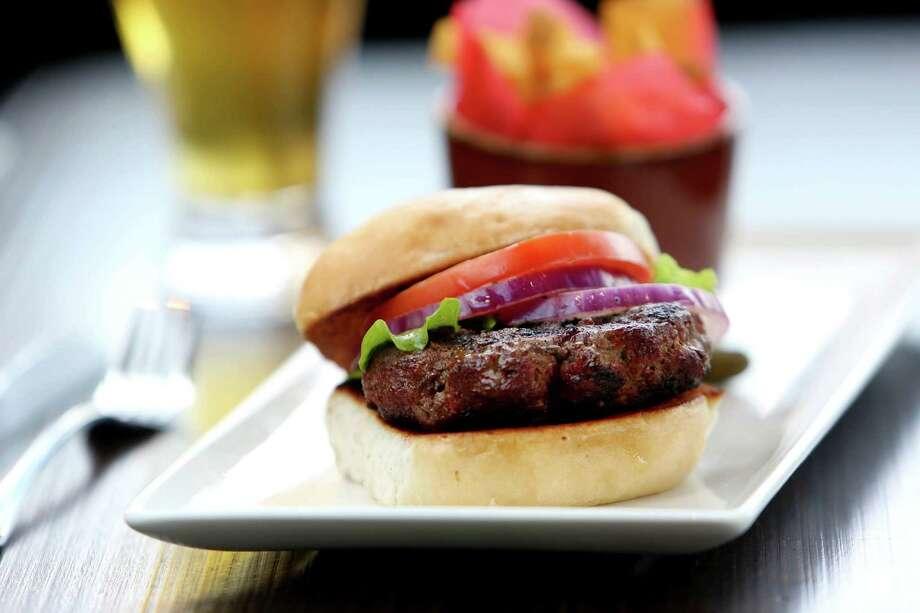 44 Farms Burger - 6oz. of Texas angus beef on a sourdough bun at Local Pour in the new Hughes Landing development  Tuesday, March 24, 2015, in The Woodlands, Texas. ( Gary Coronado / Houston Chronicle ) Photo: Gary Coronado, Staff / © 2015 Houston Chronicle