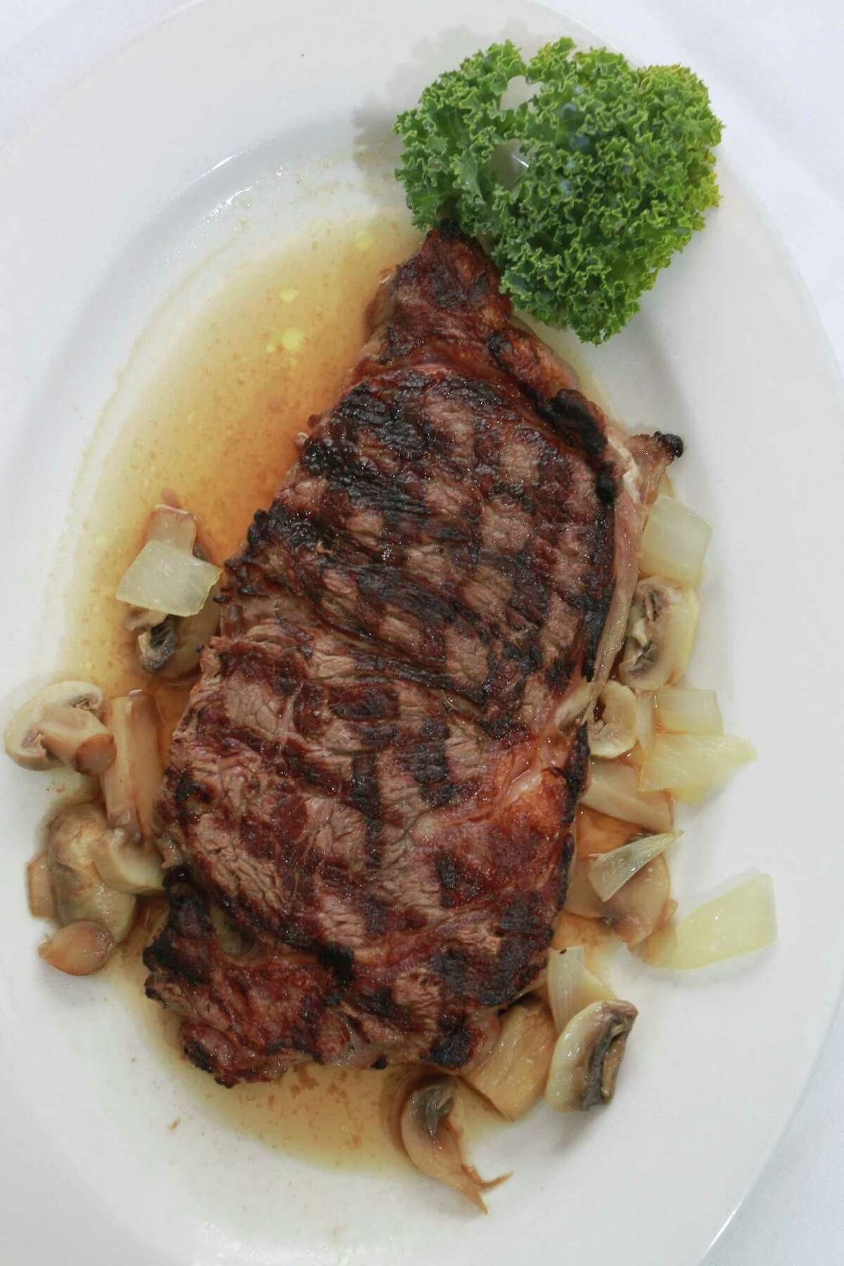 (For the Chronicle/Gary Fountain June 4, 2014) Certified Angus Beef Ribeye Steak in natural Au Jus at Christie's Steaks & Seafood.