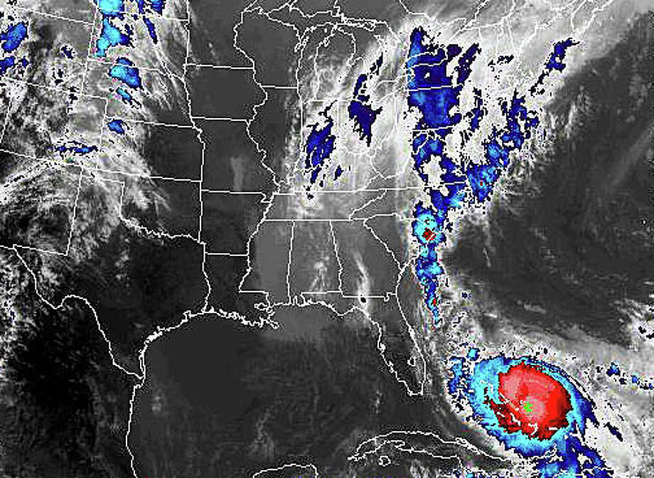 A satellite image shows Hurricane Joaquin swirling over the Caribbean late Friday, but forecasters are now predicting the brunt of the storm will not make landfall in the northeastern United States. Photo: Contributed / Contributed Photo / Westport News