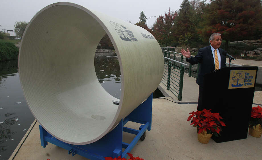 In this file photo, San Antonio Water System president/CEO Robert R. Puente speaks next to a 54-inch diameter pipe last year at an event announcing the launch of the new Vista Ridge water project. City Council will soon be asked to approve the rate structure needed to fund the pipeline. Photo: JOHN DAVENPORT /San Antonio Express-News / ©San Antonio Express-News/John Davenport