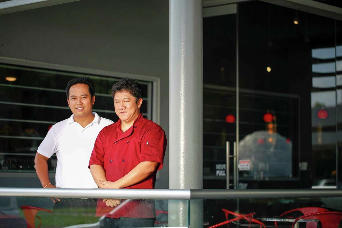 Duc Dunh, left, with his chef Vu Tuan Anh, says he felt there was a home for an Asian-style bistro in Midtown.