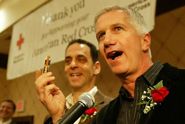 Jerry Vigorito holds up his harmonica after playing a few notes while he and Rob Fried receive a Community Impact Awards, Thu., March 25, 2010,The awards were given during the Connecticut Chapter of the American Red Cross, 2010 Heroes of Lower Fairfield Breakfast at the Trumbull Marriott. Photo: Phil Noel / Connecticut Post