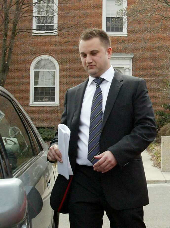 Stratford Police Officer Justin LoSchiavo leaves Stratford Town Hall, Thu., March 25, 2010, after facing a disciplinary hearing. LoSchiavo has been on light duty for seven months after having a seizure. Photo: Phil Noel / Connecticut Post