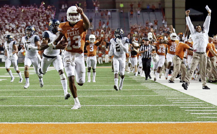 Texas Longhorns' quarterback Jerrod Heard heads to the end zone for a touchdown late in the game against the California Golden Bears earlier this month. The Longhorns lost, 45-44. Photo: Edward A. Ornelas, Staff / © 2015 San Antonio Express-News