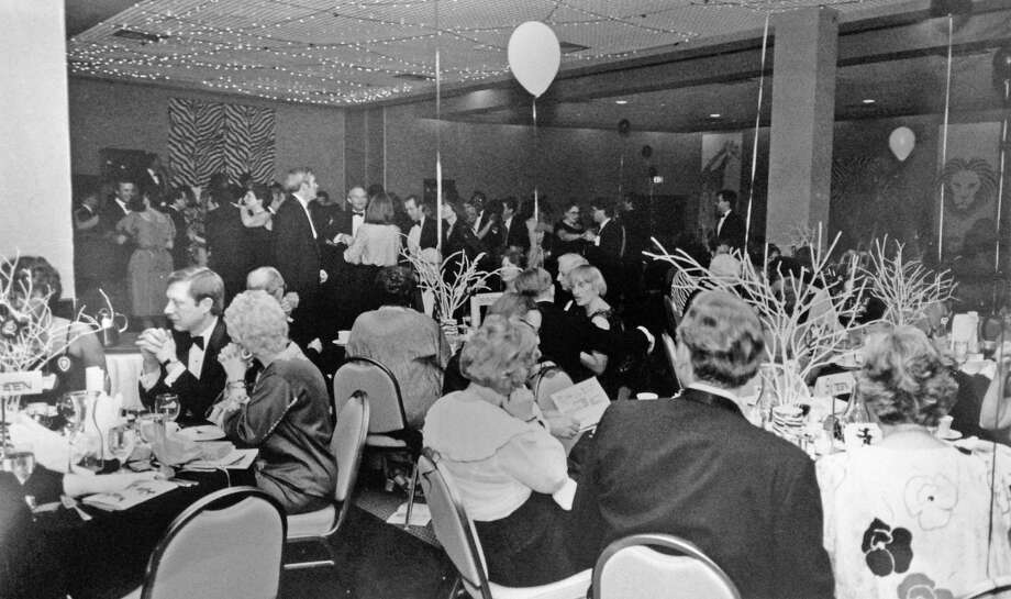 "Guests dine and mingle at the annual International Ball of the YWCA of Darien-Norwalk at the Holiday Inn Crowne Plaza Hotel of Stamford, on Summer St, in March 1985. The YWCA raffled off ""Nightfall in Nairobi,"" a 16-day photographic and wildlife safari in Kenya. Photo: Contributed / Contributed / Stamford Advocate Contributed"