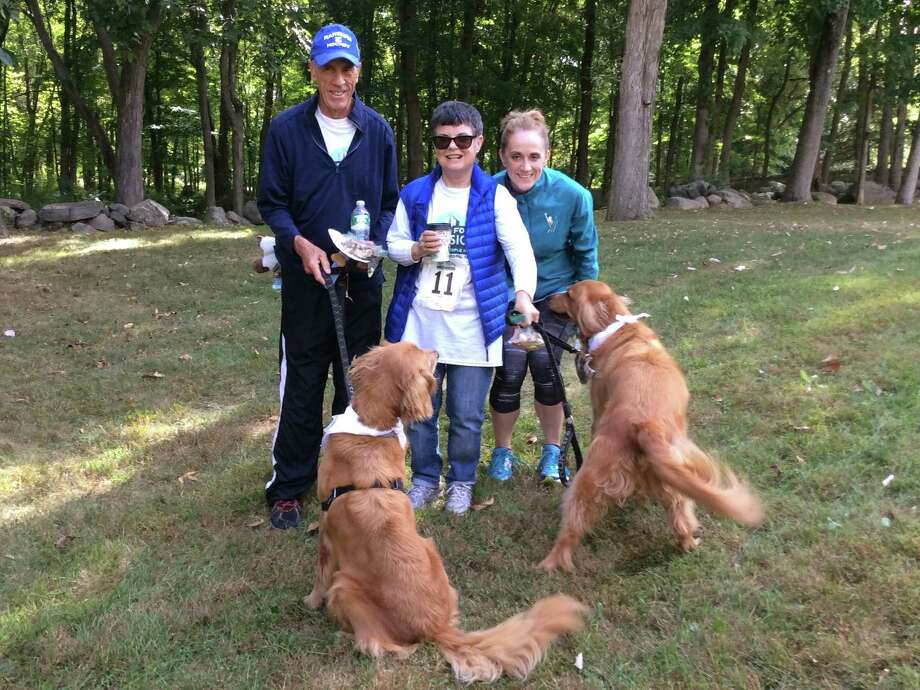 Ted Michelfelder, Gerrianne Delaney and Kristen Michelfelder with dogs Jake and Buddy at St. Francis Church's 3rd Annual Miles for a Mission Run/Walk  and 1st Annual Dogapalooza on Sept. 27. Photo: Contributed / Contributed / Stamford Advocate Contributed