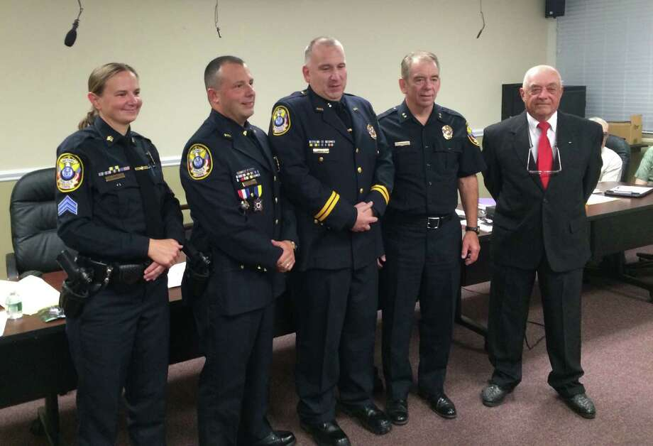 From left, Sgt. Heather Burnes, Lt. Michael Libertini, Capt. Steve Pugner, Chief Jeffrey Finch and Police Commission Chairman Michael Duff at a promotion ceremony at the Bethel municipal center in September. Photo: Contributed