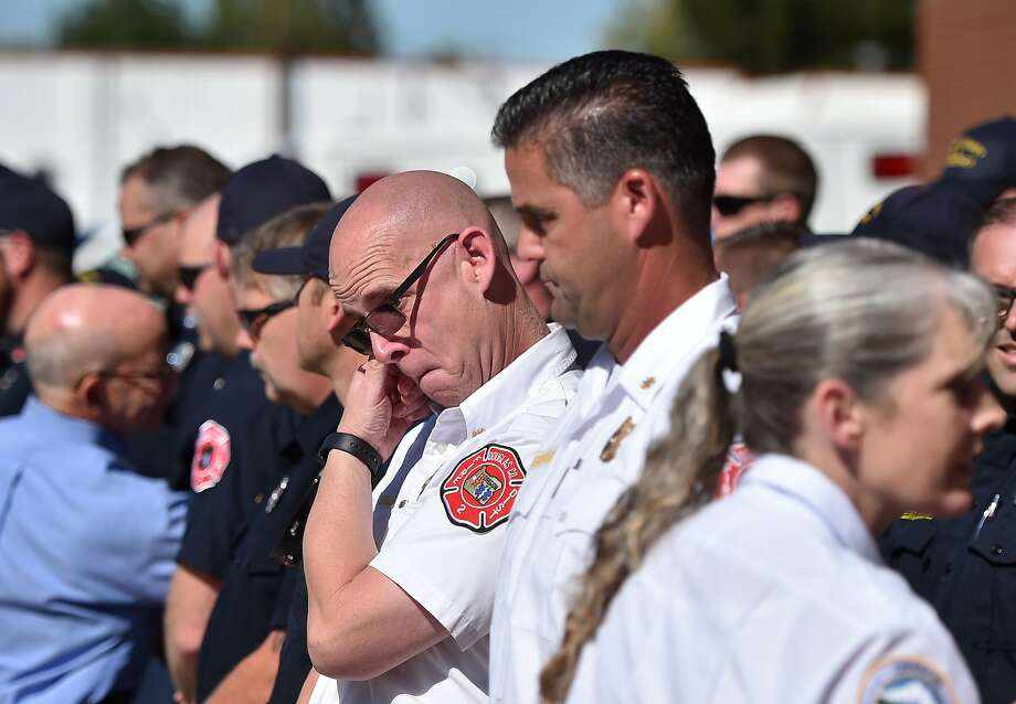 Fire Chief and first responder Greg Marlar (left) reacts after being embraced by Oregon Gov. Kate Brown following a press conference on the shootings. Photo: Josh Edelson, AFP / Getty Images